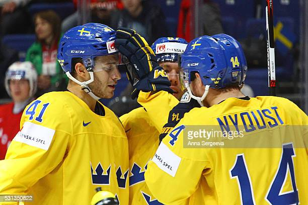 Robert Rosen of Sweden celebrates his third period goal against Norway with teammates Gustav Nyquist and Alexander Wennberg at Ice Palace on May 14...