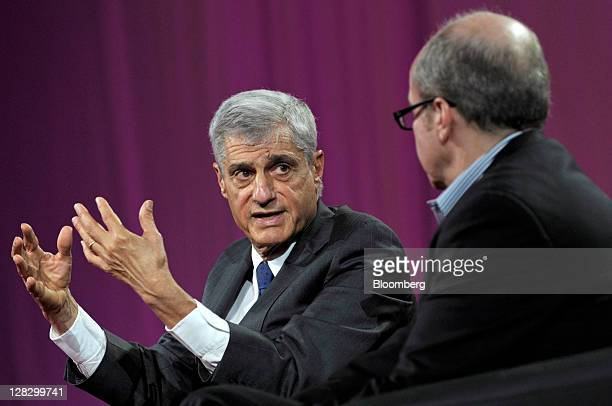 Robert Rubin former US treasury secretary left speaks while Alan Murray executive editor of The Wall Street Journal Online listens at the 2011 World...