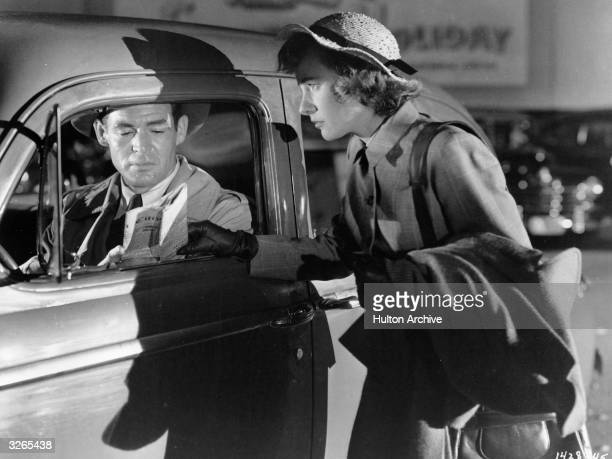 Robert Ryan and Phyllis Thaxter star in the MGM filmnoir 'Act Of Violence' directed by Fred Zinnemann