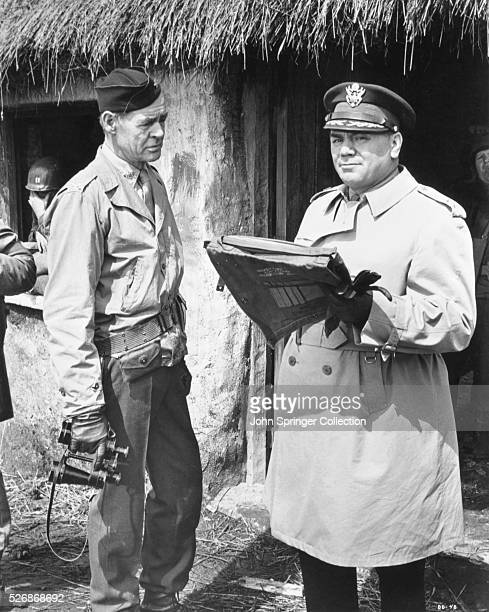 Robert Ryan as Colonel Everett Dasher Breed and Ernest Borgnine as Major General Worden in the 1967 film The Dirty Dozen.