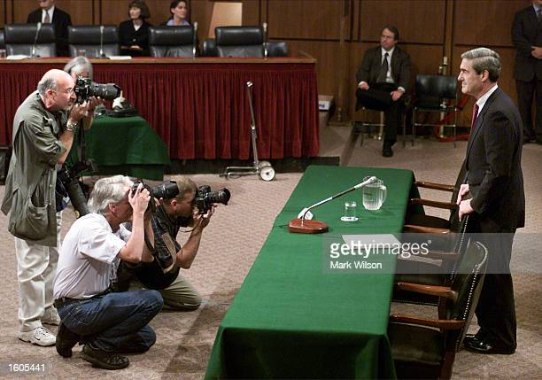 Robert S. Mueller III, President Bush''s choice to become director of the Federal Bureau of Investigation, appears at his confirmation hearing before...