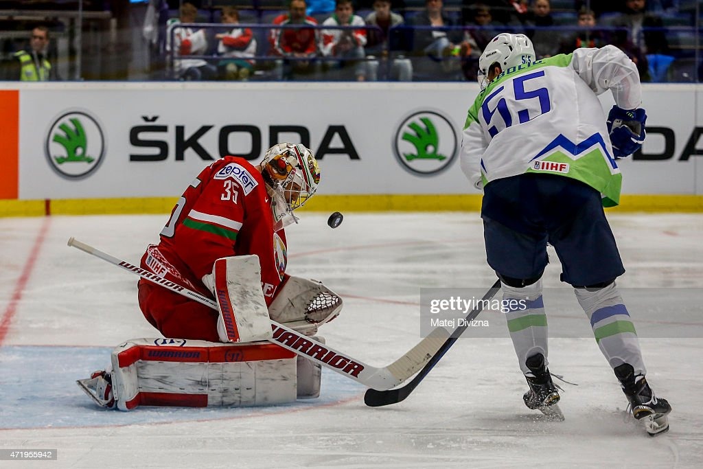 Robert Sabolic of Slovenia (R) tries to score against Kevin Lalande, goalkeeper of Belarus, during the IIHF World Championship group B match between Belarus and Slovenia at CEZ Arena on May 2, 2015 in Ostrava, Czech Republic.