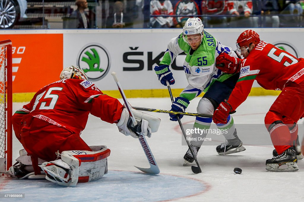 Robert Sabolic of Slovenia (C) tries to score against Kevin Lalande, goalkeeper of Belarus, during the IIHF World Championship group B match between Belarus and Slovenia at CEZ Arena on May 2, 2015 in Ostrava, Czech Republic.