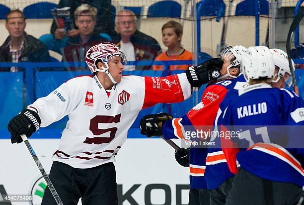 Robert Sabolic of Sparta Prague punches Rhett Rakhshani of Växjö Lakers during the Champions Hockey League group stage game between Vaxjo Lakers and...