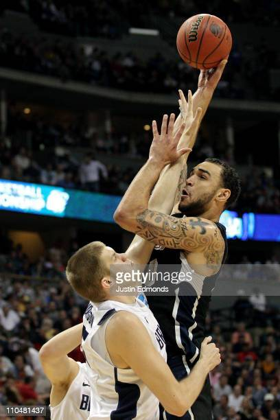 Robert Sacre of the Gonzaga Bulldogs shoots over James Anderson of the Brigham Young Cougars during the third round of the 2011 NCAA men's basketball...
