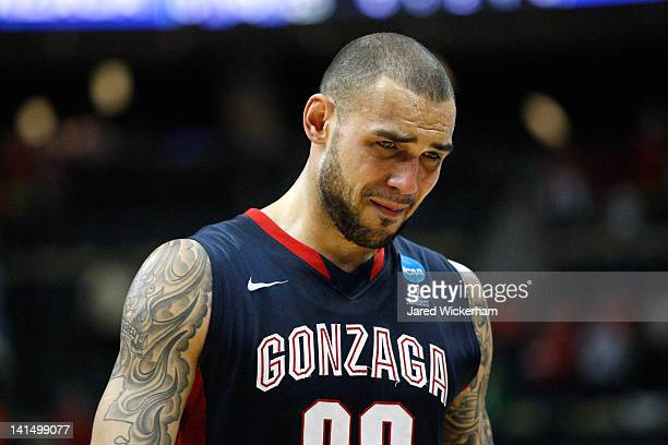 Robert Sacre of the Gonzaga Bulldogs walks off of the court dejected after they lost to the Ohio State Buckeyes 7366during the third round of the...