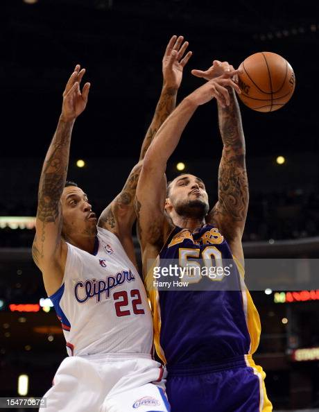 76deeb9bf Robert Sacre of the Los Angeles Lakers and Matt Barnes of the Los... News  Photo