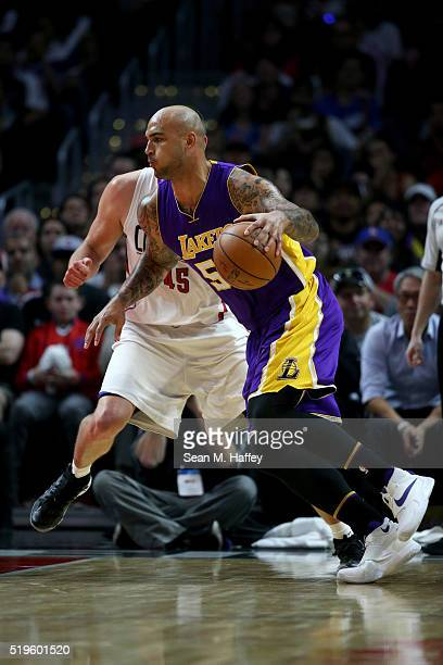 87983b253 Robert Sacre of the Los Angeles Lakers dribbles past Cole Aldrich of the Los  Angeles Clippers