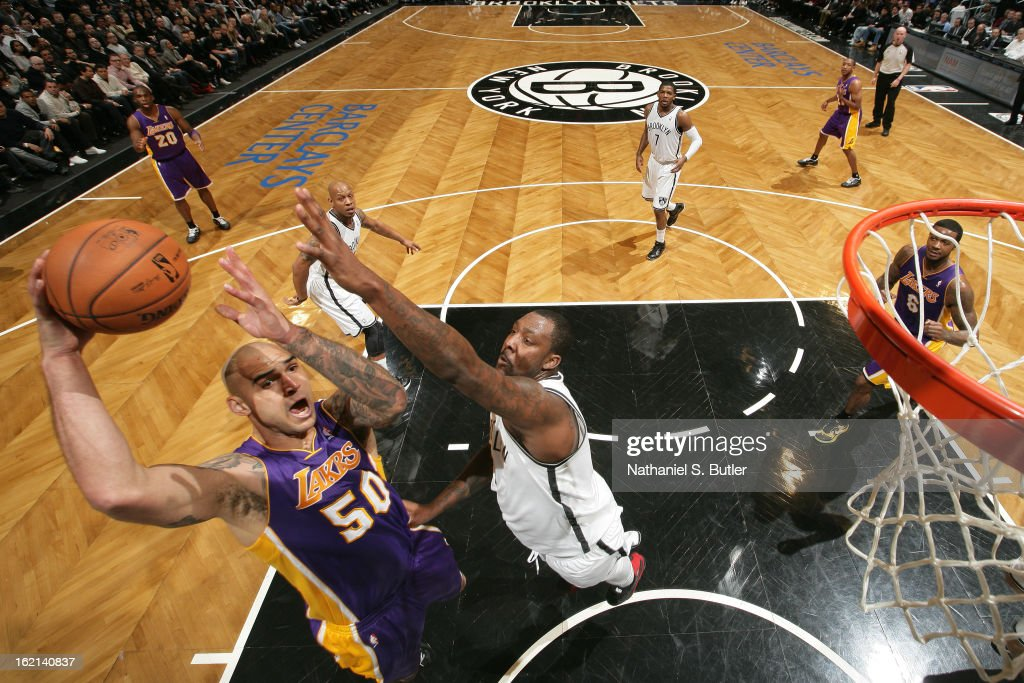 Robert Sacre #50 of the Los Angeles Lakers drives to the basket against the Brooklyn Nets on February 5, 2013 at the Barclays Center in the Brooklyn borough of New York City.
