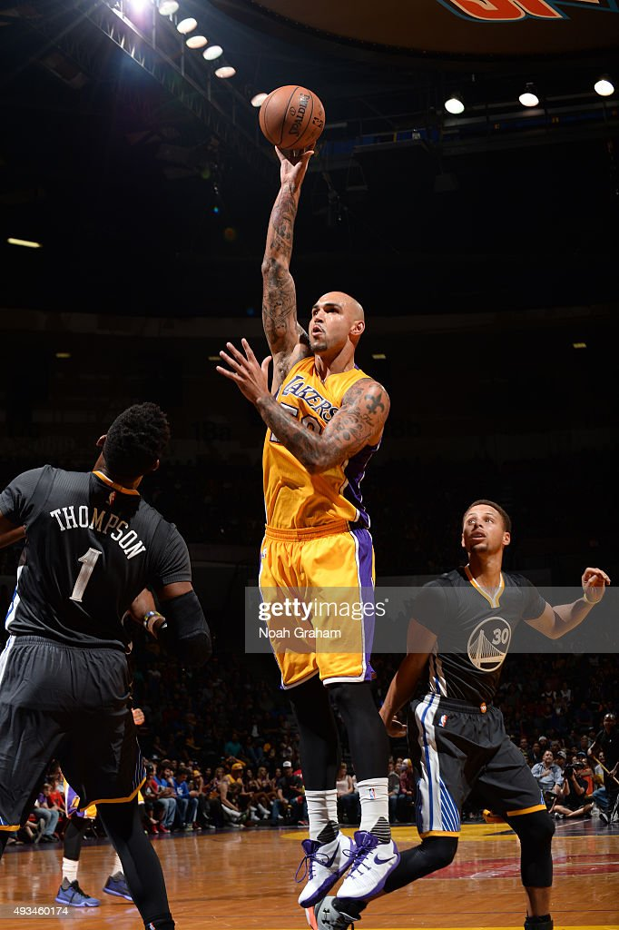 Robert Sacre #50 of the Los Angeles Lakers shoots the ball against the Golden State Warriors during a preseason game on October 17, 2015 at Valley View Casino Center in San Diego, California.