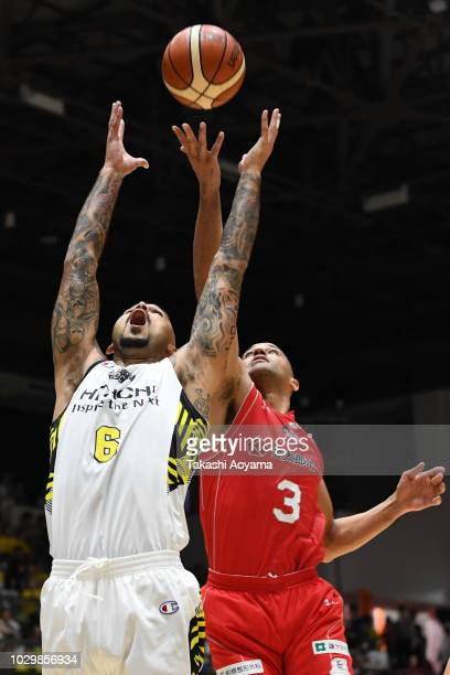 Robert Sacre of the Sun Rockers Shibuya contests a rebound with Michael Parker of the Chiba Jets during the B.League Early Cup Kanto 3rd Place Game...