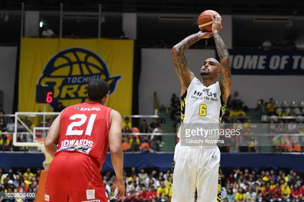 Robert Sacre of the Sun Rockers Shibuya shoots over Gavin Edwards of the Chiba Jets during the B.League Early Cup Kanto 3rd Place Game between Chiba...