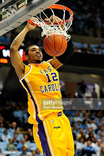 Robert Sampson of the East Carolina Pirates dunks against the North Carolina Tar Heels during play at the Dean Smith Center on December 15 2012 in...