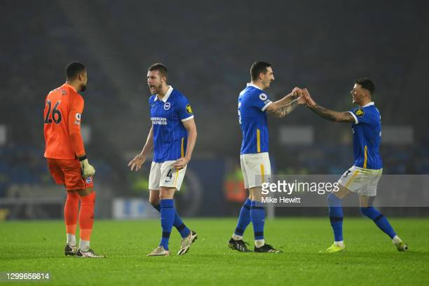 Robert Sanchez, Adam Webster, Lewis Dunk and Ben White of Brighton & Hove Albion celebrate victory following the Premier League match between...