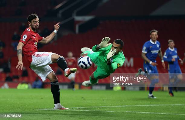 Robert Sanchez of Brighton & Hove Albion saves a shot from Bruno Fernandes of Manchester United during the Premier League match between Manchester...