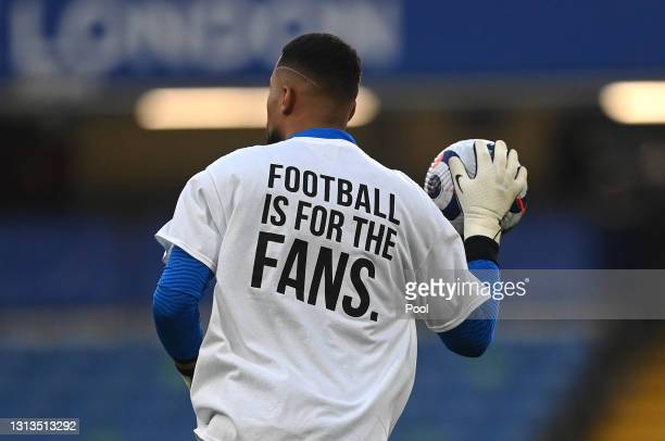 Robert Sanchez of Brighton & Hove Albion warms up wearing a t-shirt with a message in protest against the European Super League prior to the Premier...
