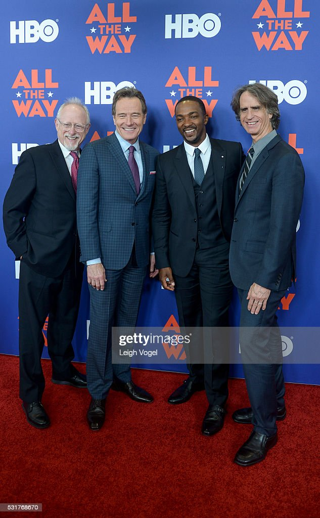 Robert Schenkkan, Bryan Cranston, Anthony Mackie and Jay Roach pose for photos on the red carpet during the HBO 'All the Way' premiere at The National Archives on May 16, 2016 in Washington, DC.