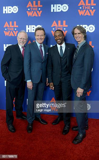 Robert Schenkkan Bryan Cranston Anthony Mackie and Jay Roach pose for photos on the red carpet during the HBO 'All the Way' premiere at The National...