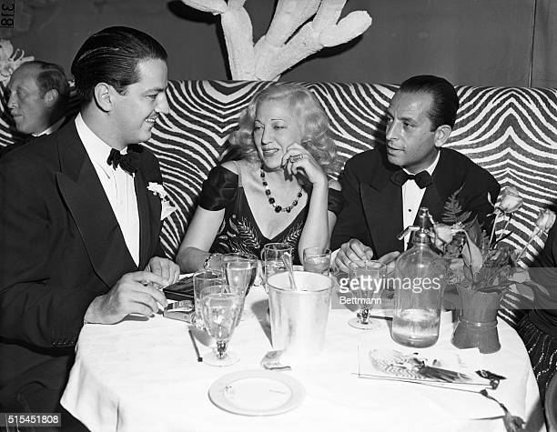 Robert Scott sits with his mother Mabel Boll known as the Diamond Queen for her large collection of jewelry and Theodore Cella during openingnight...