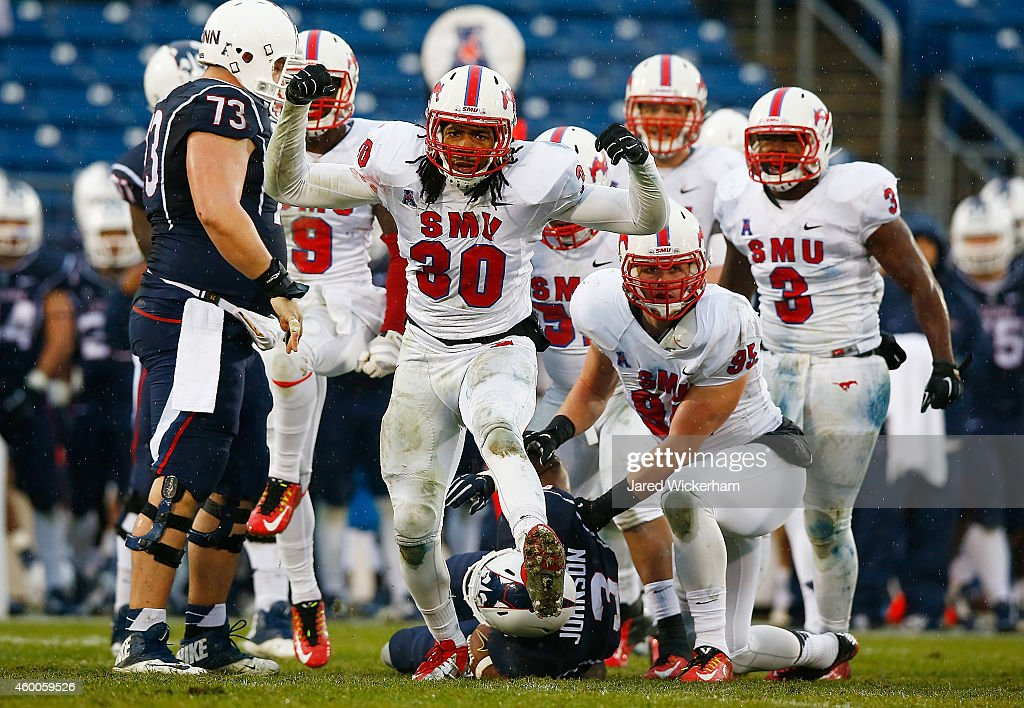 Robert Seals #30 of the SMU Mustangs celebrates a defensive stop in the second half against the Connecticut Huskies during the game at Rentschler Field on December 6, 2014 in East Hartford, Connecticut.