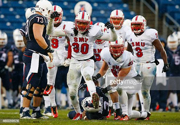 Robert Seals of the SMU Mustangs celebrates a defensive stop in the second half against the Connecticut Huskies during the game at Rentschler Field...