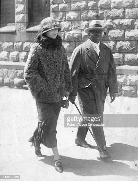 Robert Sengstacke Abbott , founder and publisher of the Chicago Defender newspaper, walks down a Chicago street with his wife Helen, early twentieth...