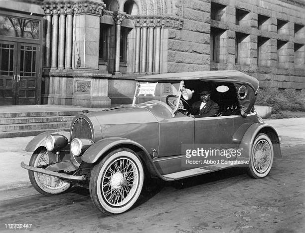 Robert Sengstacke Abbott sits in the driver's seat of the official car for the Fourth Liberty Loan drive, in support of America's efforts during...
