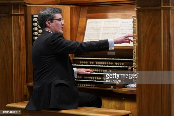 Robert Sharpe, Director of Music at York Minster plays the Grand Organ in the cathedral's Nave on March 5, 2021 in York, England. The playing comes...
