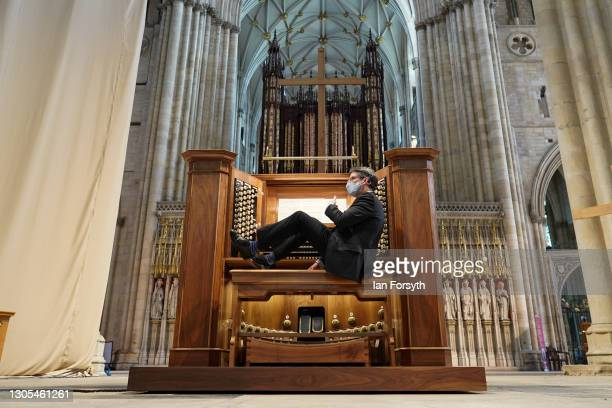 Robert Sharpe, Director of Music at York Minster takes his seat to play the Grand Organ in the cathedral's Nave on March 5, 2021 in York, England....