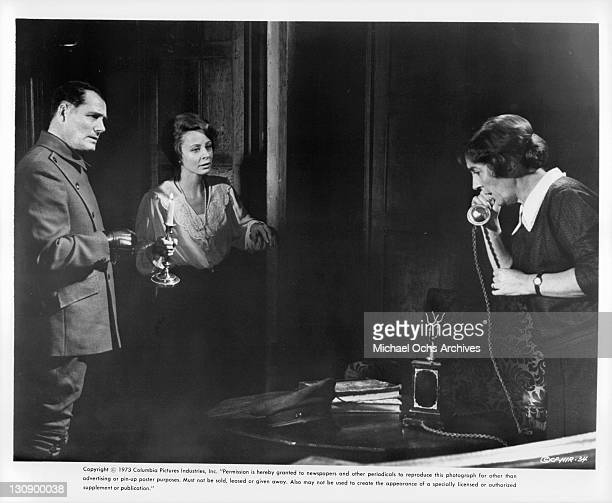 Robert Shaw And Sarah Miles speaking to woman in a scene from the film 'The Hireling' 1973