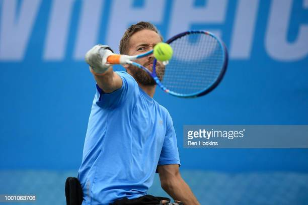 Robert Shaw of Canada plays a backhand during his match against Heath Davidson of Australia on day two of The British Open Wheelchair Tennis...