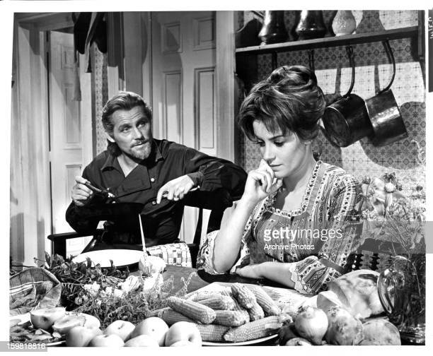 Robert Shaw talks with Mary Ure in a scene from the film 'Custer Of The West', 1967.