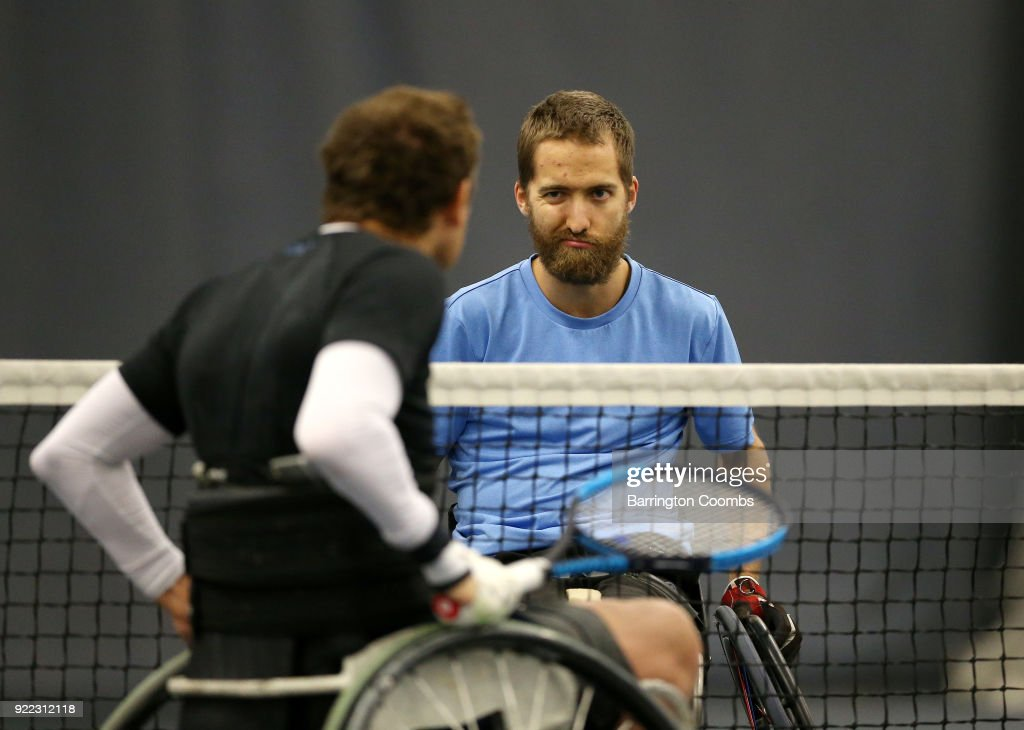 Robert Shaw (CAN) winks at Anthony Cotterill (GBR) before their match during the 2018 Bolton Indoor Wheelchair Tennis Tournament at Bolton Arena on February 21, 2018 in Bolton, England.
