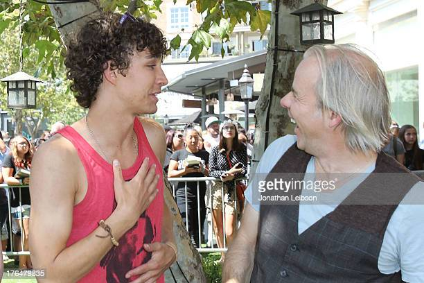 Robert Sheehan and Harald Zwart attend the 'The Mortal Instruments City Of Bones' meet and greet at The Americana at Brand on August 13 2013 in...