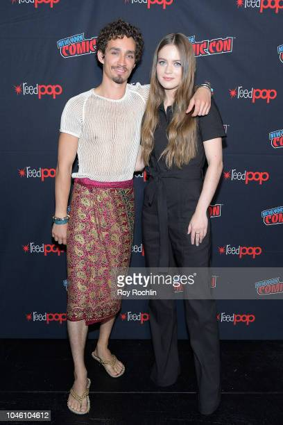 Robert Sheehan and Hera Hilmarsdottir attend the Mortal Engines panel during the New York Comic Con 2018 at Javits Center on October 5 2018 in New...