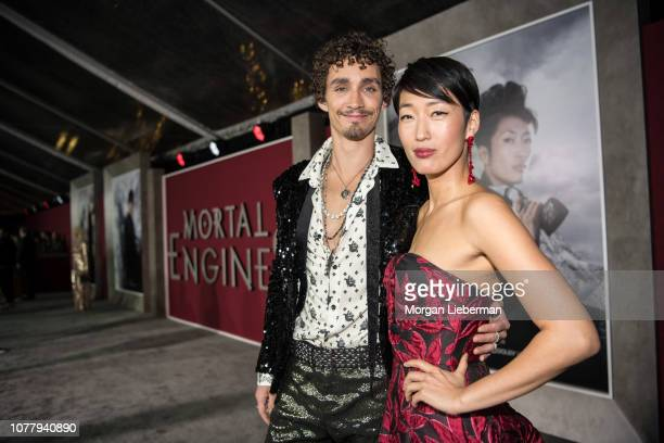 Robert Sheehan and Jihae arrive at the premiere Of Universal Pictures' 'Mortal Engines' at Regency Village Theatre on December 5 2018 in Westwood...