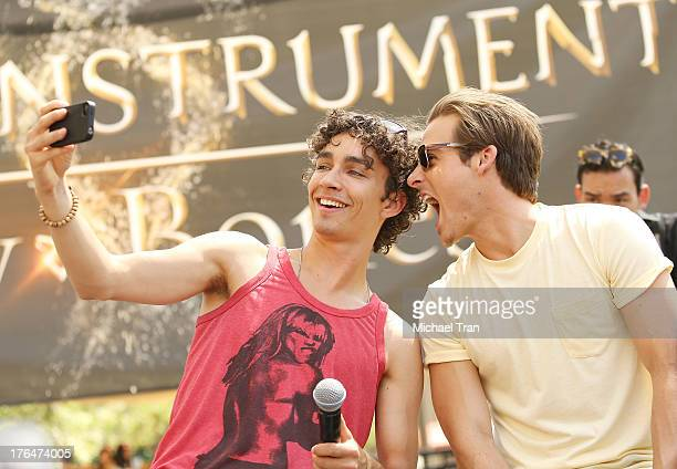 Robert Sheehan and Kevin Zegers attend 'The Mortal Instruments City Of Bones' event held at The Americana at Brand on August 13 2013 in Glendale...