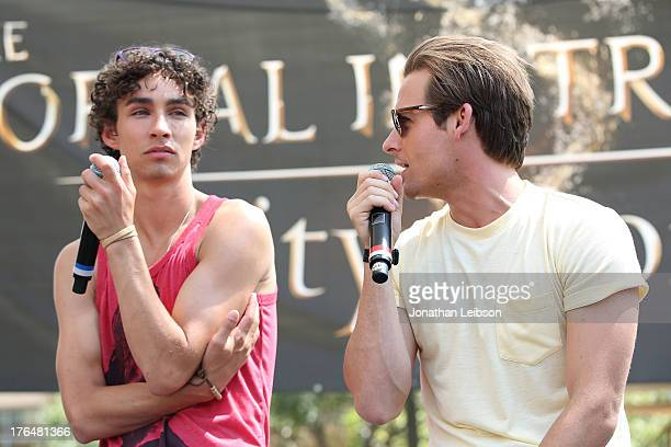 Robert Sheehan and Kevin Zegers attend the 'The Mortal Instruments City Of Bones' meet and greet at The Americana at Brand on August 13 2013 in...
