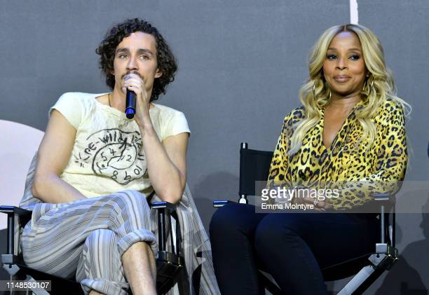Robert Sheehan and Mary J Blige speak onstage at Netflix's 'Umbrella Academy' Screening at Raleigh Studios on May 11 2019 in Los Angeles California