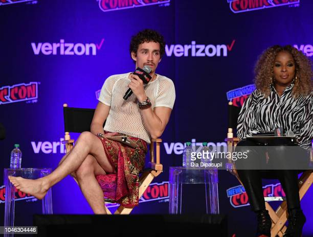Robert Sheehan and Mary J Blige speak onstage at the Netflix Chills panel during New York Comic Con 2018 at Jacob K Javits Convention Center on...