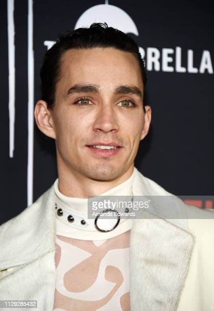 Robert Sheehan arrives at the premiere of Netflix's 'The Umbrella Academy' at the ArcLight Hollywood on February 12 2019 in Hollywood California