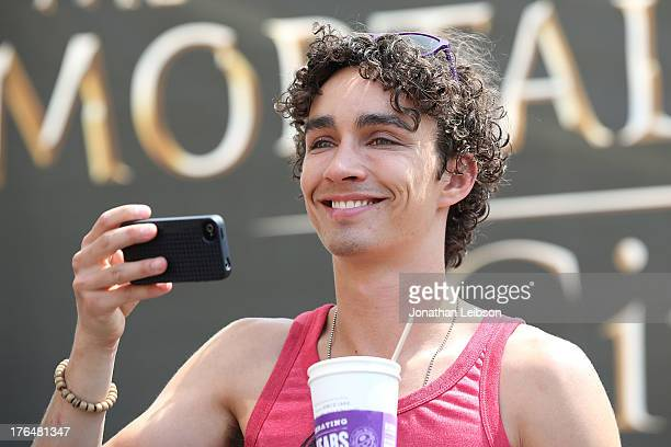 Robert Sheehan attends the 'The Mortal Instruments City Of Bones' meet and greet at The Americana at Brand on August 13 2013 in Glendale California