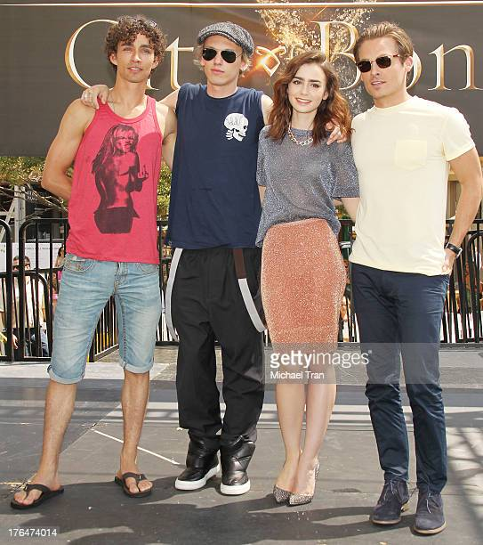 Robert Sheehan Jamie Campbell Bower Lily Collins and Kevin Zegers attend 'The Mortal Instruments City Of Bones' event held at The Americana at Brand...