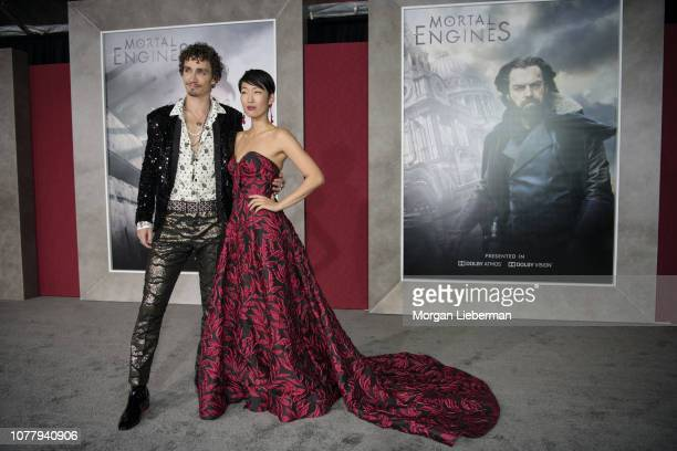 Robert Sheehan Jihae arrive at the premiere Of Universal Pictures' Mortal Engines at Regency Village Theatre on December 5 2018 in Westwood California