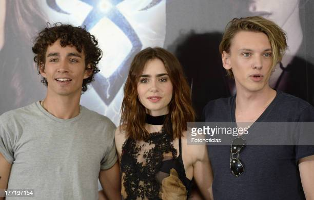 Robert Sheehan Lily Collins and Jamie Campbell Bower attend a photocall for 'The Mortal Instruments City Of Bones' at Villamagna Hotel on August 22...