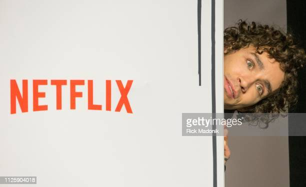 Robert Sheehan peeks out from behind as he waits for his turn on the carpet Bell TIFF Lightbox hosted a screening of new superhero movie The Umbrella...