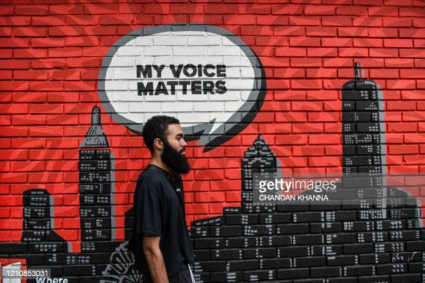 Robert Sherrill , poses against a wall in Atlanta, Georgia, on April 23, 2020. - The US state of Georgia takes a massive gamble on April 24 when it...