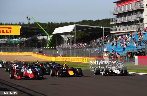 Robert Shwartzman of Russia and Prema Racing , Juri Vips of Estonia and Hitech Grand Prix and Christian Lundgaard of Denmark and ART Grand Prix...
