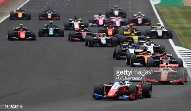 Robert Shwartzman of Russia and Prema Racing leads Mick Schumacher of Germany and Prema Racing and the rest of the field into turn one at the start...