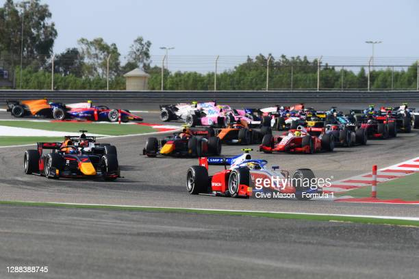 Robert Shwartzman of Russia and Prema Racing leads Yuki Tsunoda of Japan and Carlin and the rest of the field into turn two at the start during the...